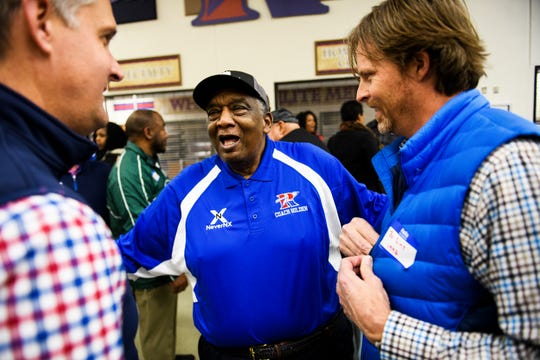 Louie Golden laughs with Chris League and Bo Sims, two of his former basketball players, during a night honoring his accomplished career as a prep basketball coach on Friday, Jan. 25 2019 at Riverside High School.