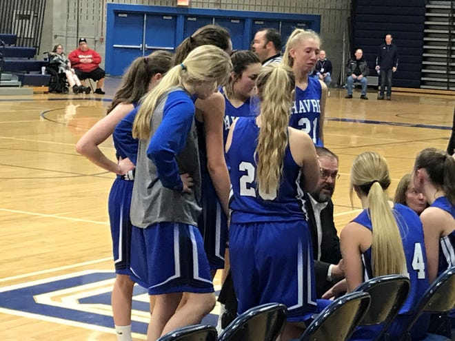 Havre coach Dustin Kraske talks to his team during a timeout. The defending state champion Blue Ponies defeated Great Falls High 43-28 on Friday night at Swarthout Fieldhouse in Great Falls.
