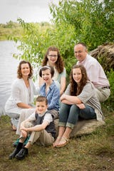 The family of Elizabeth and Jeremy Hill includes daughters Mary, 17, Kathryn, 14, and Hannah, 12, and son Ben, 10.