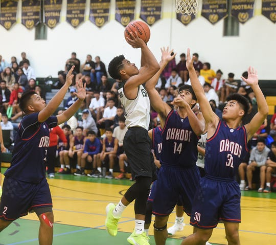 John F. Kennedy High School player Jerry Ngiraremiang drives to the basket against the Okkodo Bulldogs during their Independent Interscholastic Athletic Association of Guam Boys' Basketball game at the JFK High School gym, Jan. 25, 2019.