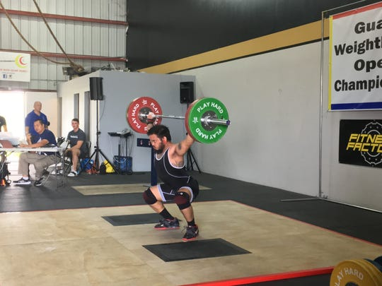 Edward John Fejeran successfully completes a snatch at the Guam Weightlifting Open Championship held Jan. 26, 2019 at Chamorri CrossFit in Tamuning.