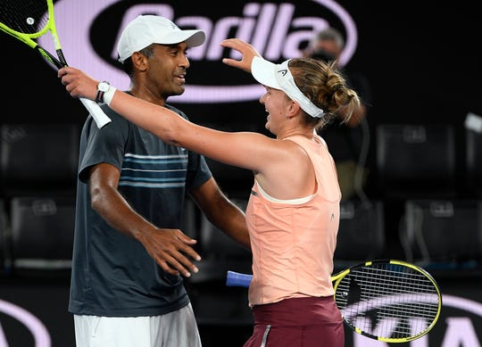 Barbora Krejcikova, right, of the Czech Republic and United States' Rajeev Ram celebrate after defeating Australia's Astra Sharma and compatriot John-Patrick Smith in the mixed doubles final at the Australian Open tennis championships in Melbourne, Australia, early Sunday, Jan. 27, 2019. (AP Photo/Andy Brownbill)