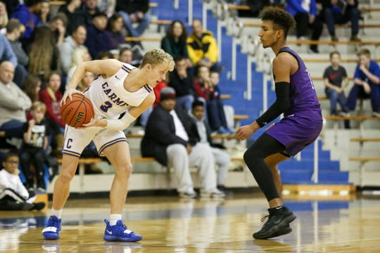 Carmel's Karsten Windlan (3) looks for an opening during the first half of Carmel vs. Ben Davis High School varsity basketball held at Carmel High School, January 25, 2019.