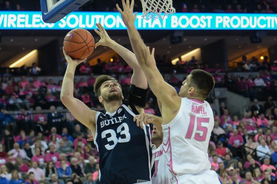 Butler Bulldogs forward Bryce Golden (33) attempts a shot over Creighton Bluejays forward Martin Krampelj (15) in the first half at CHI Health Center Omaha.