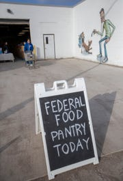 A sign announcing that federal workers who had been affected by the partial government shutdown could get pet supplies at IndyHumane's Animal Welfare Center, Indianapolis, Saturday, Jan. 26, 2019.