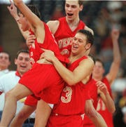 Tri-West coach Adam Bontreger (back) won a state title as a player at Westview.