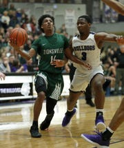 Zionsville Eagles Isaiah Thompson (11) drives on Brownsburg Bulldogs Cameron Alford (3) in the first half of their game at Brownsburg High School Friday, Jan. 25, 2019.