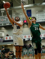Brownsburg Bulldogs Reis Thomas (10) drives on Zionsville Eagles Nathan Childress (24) Jan. 25, 2019.