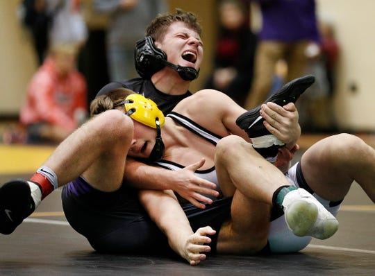 Brownburg's Drew Kreitzer grimaces in pain as he wrestles Avon's Jaden Reynolds during their 138 lbs. match during the IHSAA Wrestling Sectional #25 meet at Avon High School Friday, Jan. 26, 2019.