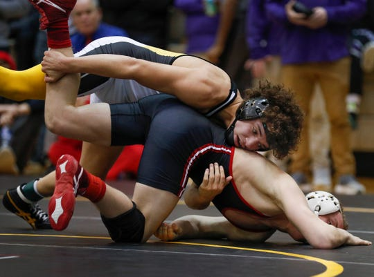 Avon's Asa Garcia, top, works on Plainfiled's Boe Logan duing their 132 lb. match during the IHSAA Wrestling Sectional #25 meet at Avon High School Friday, Jan. 26, 2019.