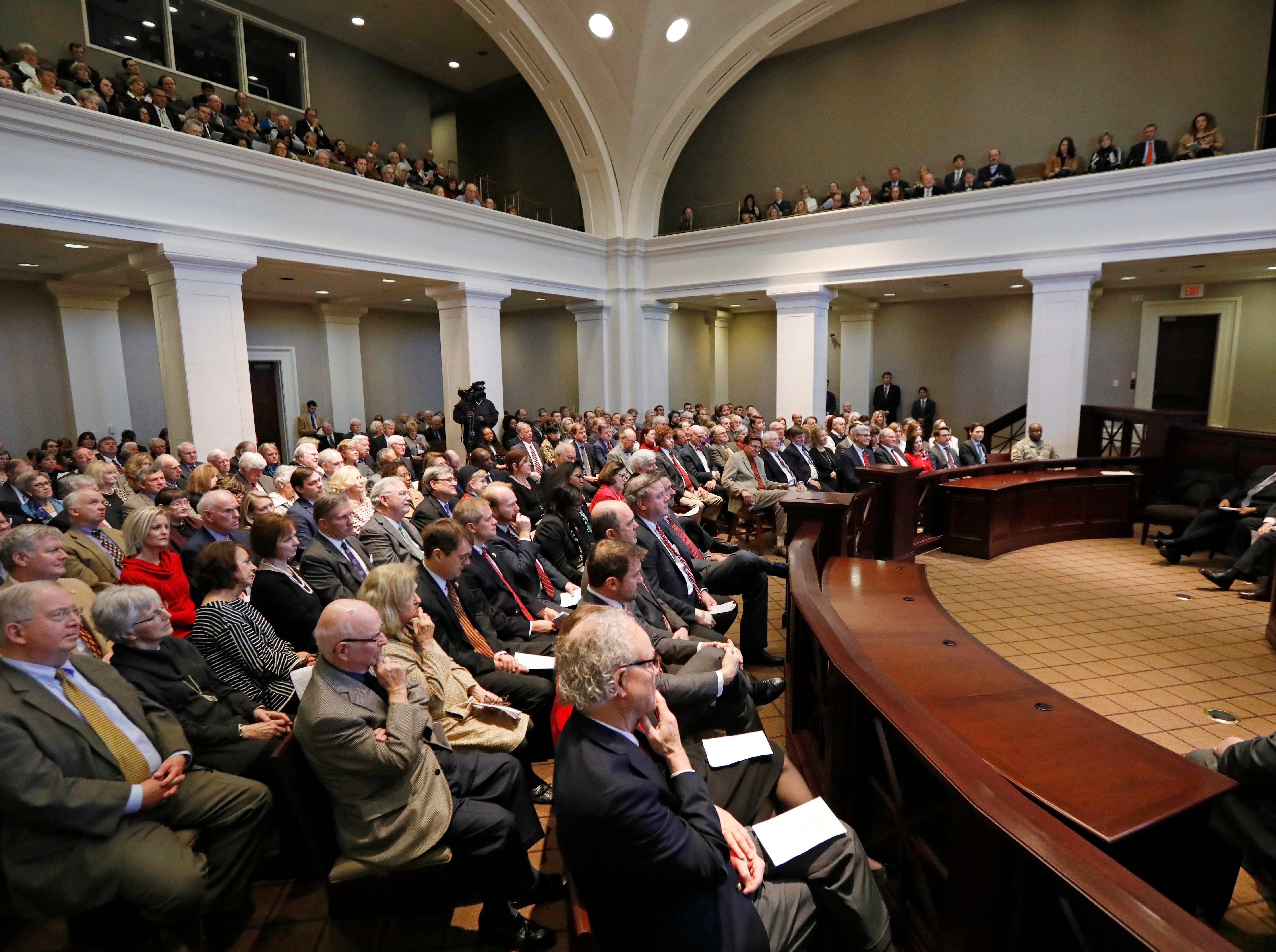A filled chamber witnesses Mississippi Supreme Court Chief Justice William L. Waller Jr.'s retirement ceremony in the state Supreme Court chambers in Jackson, Miss., Friday, Jan. 25, 2019. Waller officially retires on January 31 after more than 21 years of service on the Supreme Court and 10 years as Chief Justice. (AP Photo/Rogelio V. Solis)