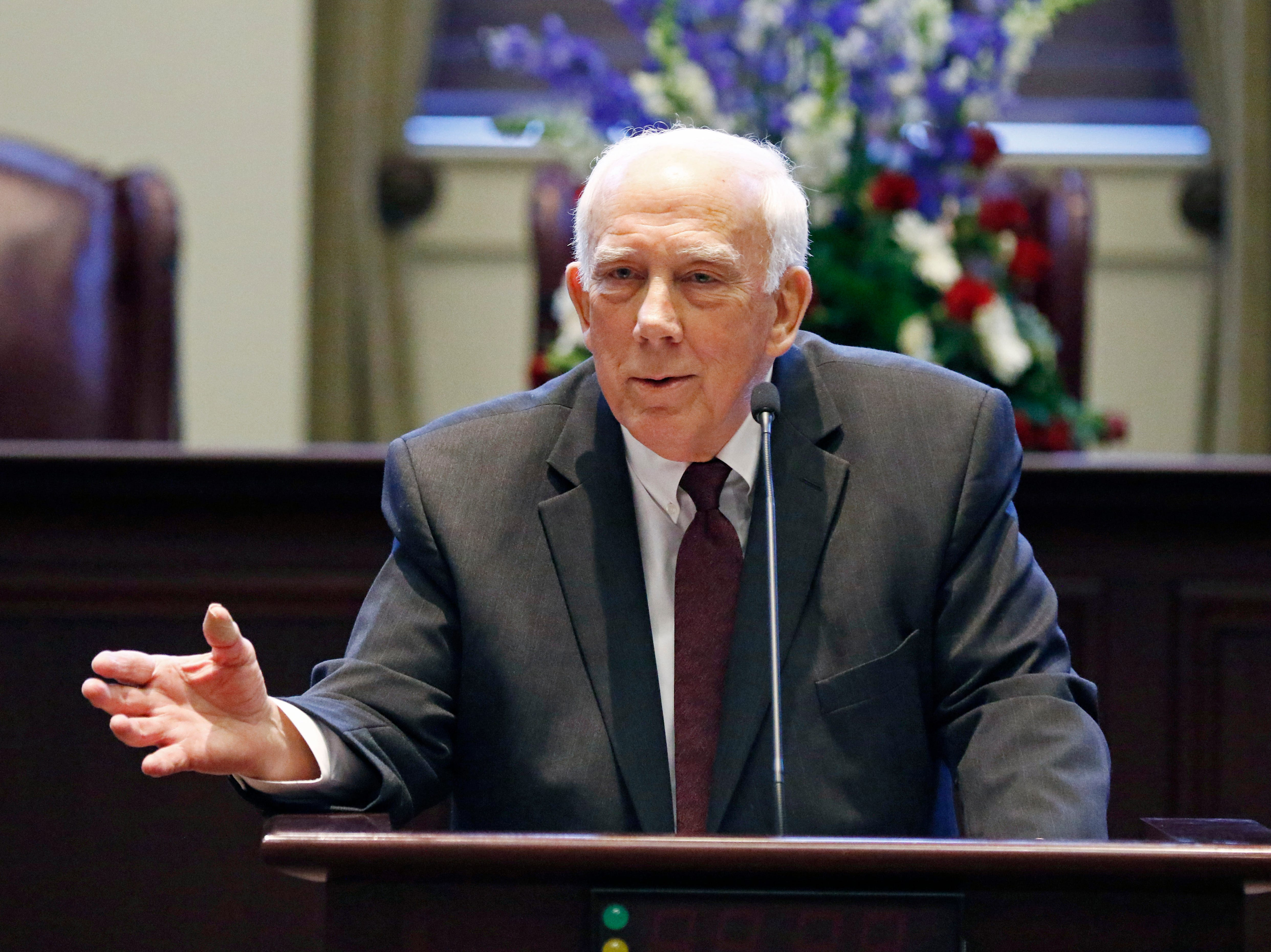 Presiding Supreme Court Justice James W. Kitchens, tells a story about his friend, Mississippi Supreme Court Chief Justice William L. Waller Jr., during a retirement ceremony honoring Waller at the Mississippi Supreme Court chambers in Jackson, Miss., Friday, Jan. 25, 2019. Waller officially retires on January 31 after more than 21 years of service on the Supreme Court and 10 years as Chief Justice. (AP Photo/Rogelio V. Solis)