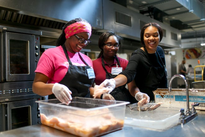 Jade Ross, 17, left, Shadimon Randaul, 17, center, and Toneice Bell, 16, right, prepare chicken breasts for cooking at Brooks Shaw's Old Country Store in Jackson, Tenn., on Friday, Jan. 25, 2019.