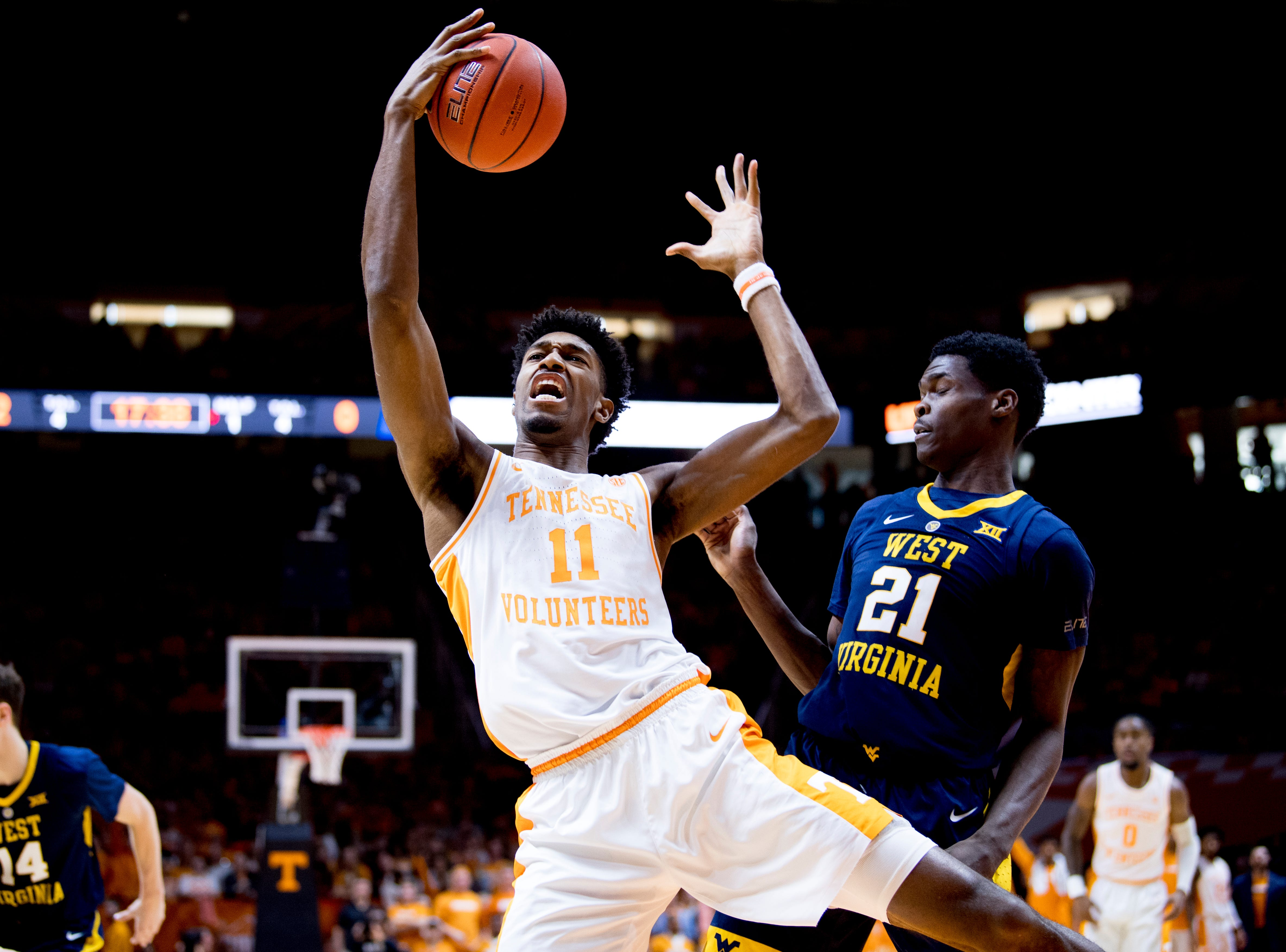 Tennessee forward Kyle Alexander (11)  grabs the rebound ball during a SEC/Big 12 Challenge game between Tennessee and West Virginia at Thompson-Boling Arena in Knoxville, Tennessee on Saturday, January 26, 2019.