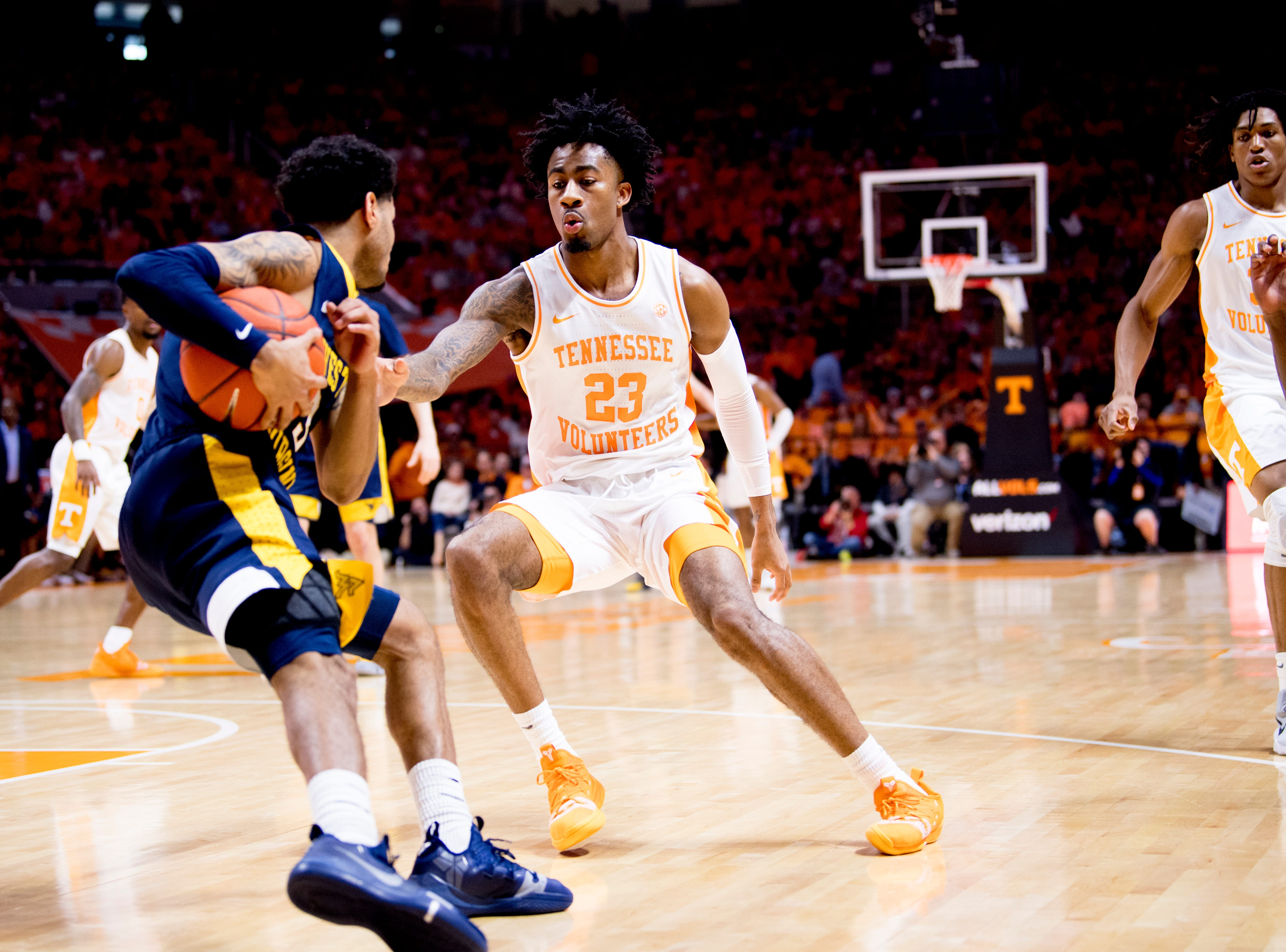Tennessee guard Jordan Bowden (23) defends against West Virginia guard James Bolden (3) during a SEC/Big 12 Challenge game between Tennessee and West Virginia at Thompson-Boling Arena in Knoxville, Tennessee on Saturday, January 26, 2019.