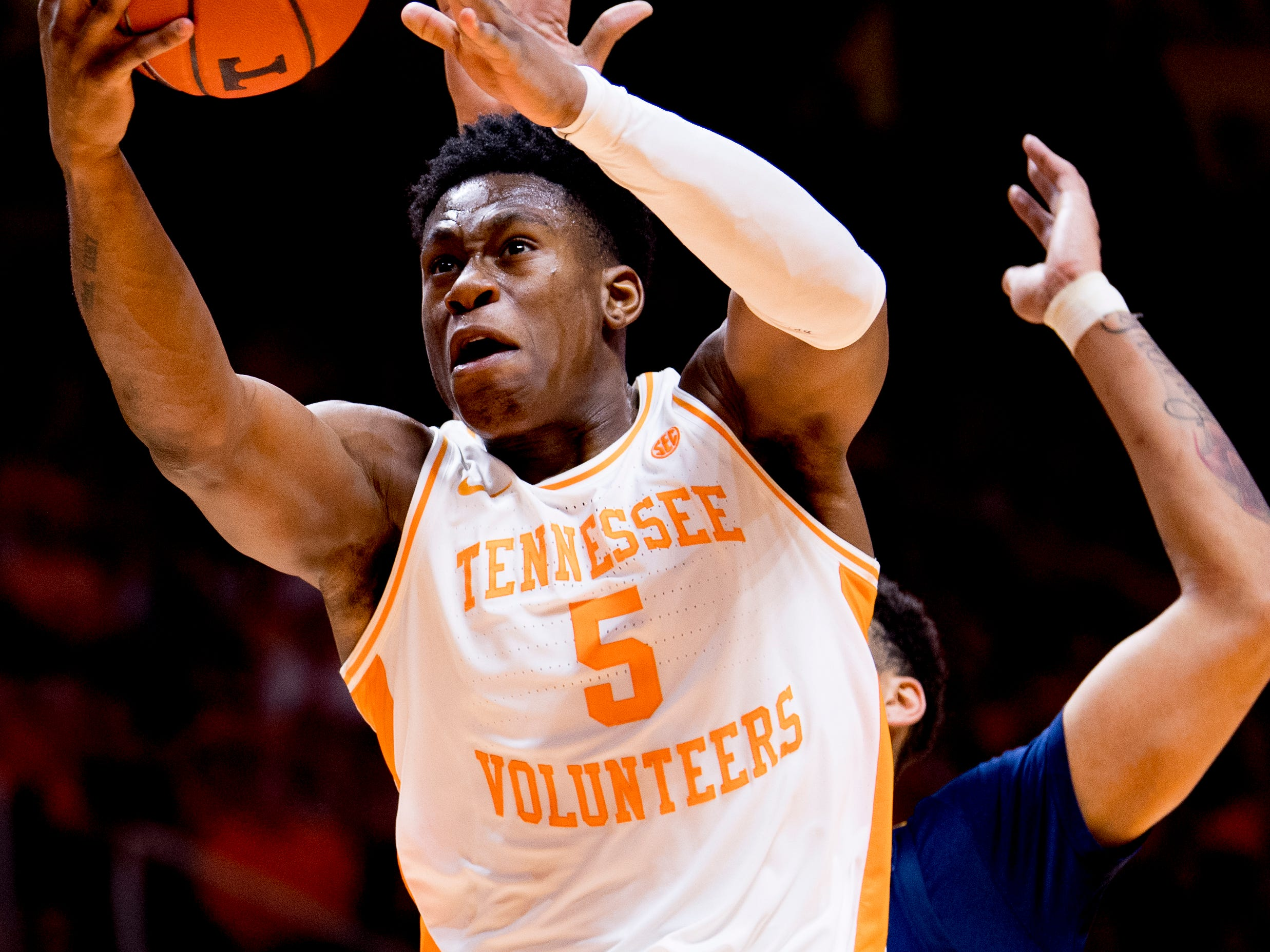 Tennessee guard Admiral Schofield (5) goes for a point during a SEC/Big 12 Challenge game between Tennessee and West Virginia at Thompson-Boling Arena in Knoxville, Tennessee on Saturday, January 26, 2019.