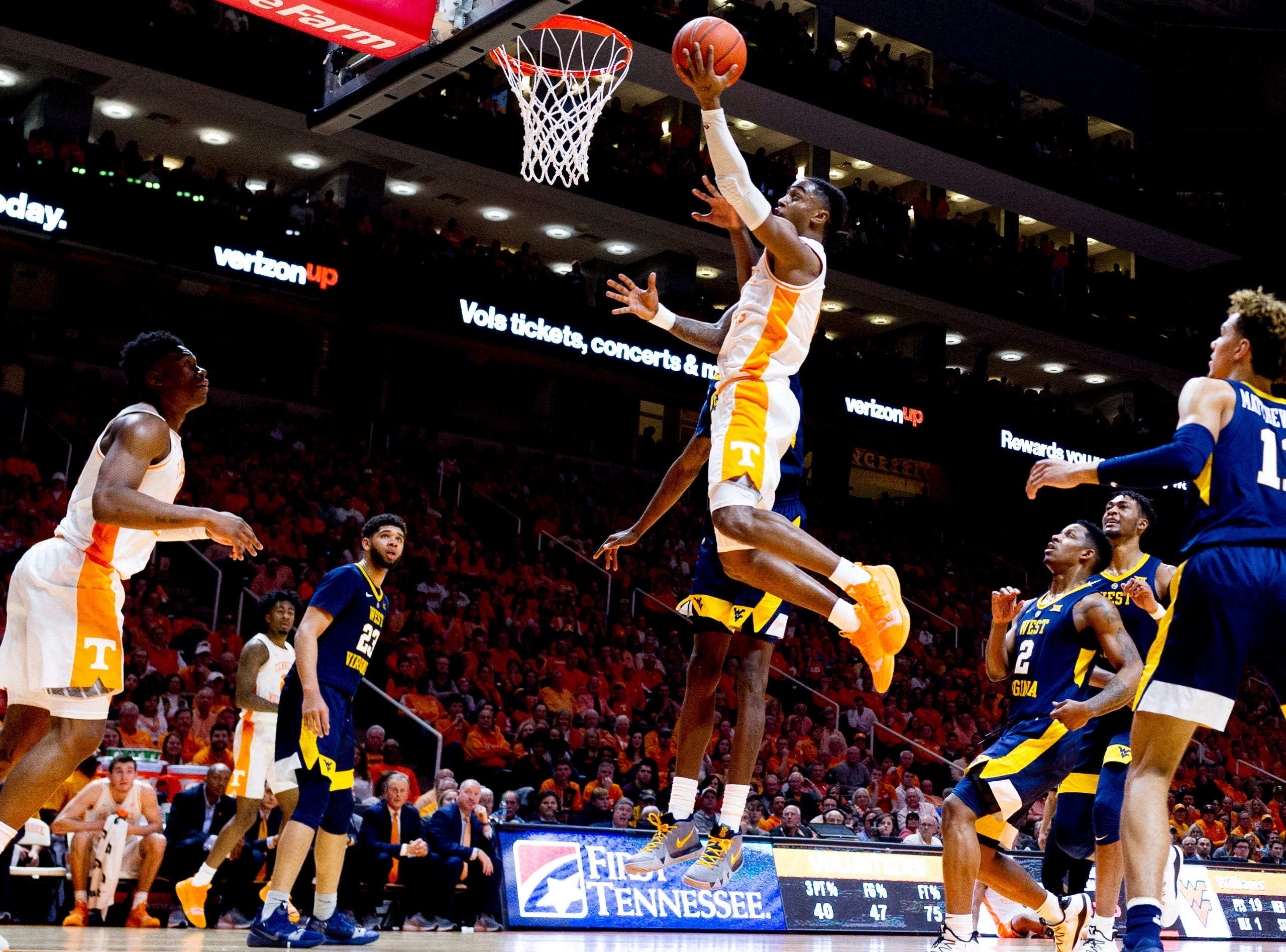 Tennessee guard Jordan Bone (0) shoots the ball during a SEC/Big 12 Challenge game between Tennessee and West Virginia at Thompson-Boling Arena in Knoxville, Tennessee on Saturday, January 26, 2019.