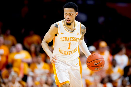 Tennessee guard Lamonte Turner (1) dribbles down the court during a SEC/Big 12 Challenge game between Tennessee and West Virginia at Thompson-Boling Arena in Knoxville, Tennessee on Saturday, January 26, 2019.