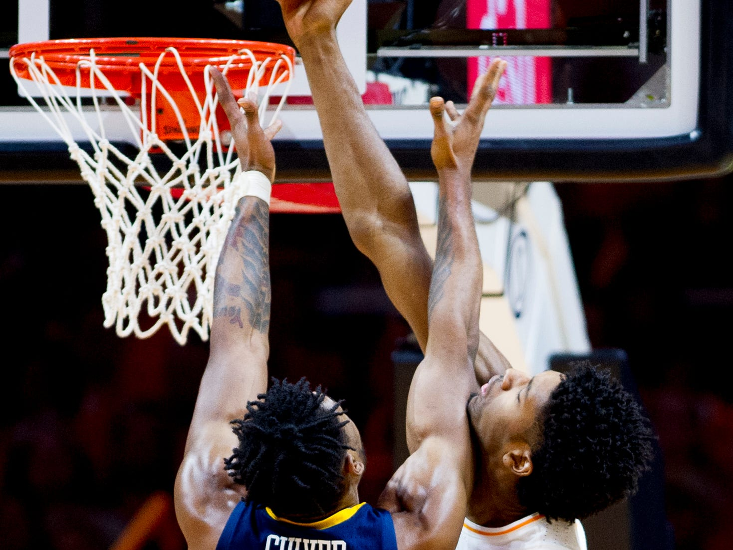 West Virginia forward Derek Culver (1) goes for a point as Tennessee forward Kyle Alexander (11) defends during a SEC/Big 12 Challenge game between Tennessee and West Virginia at Thompson-Boling Arena in Knoxville, Tennessee on Saturday, January 26, 2019.
