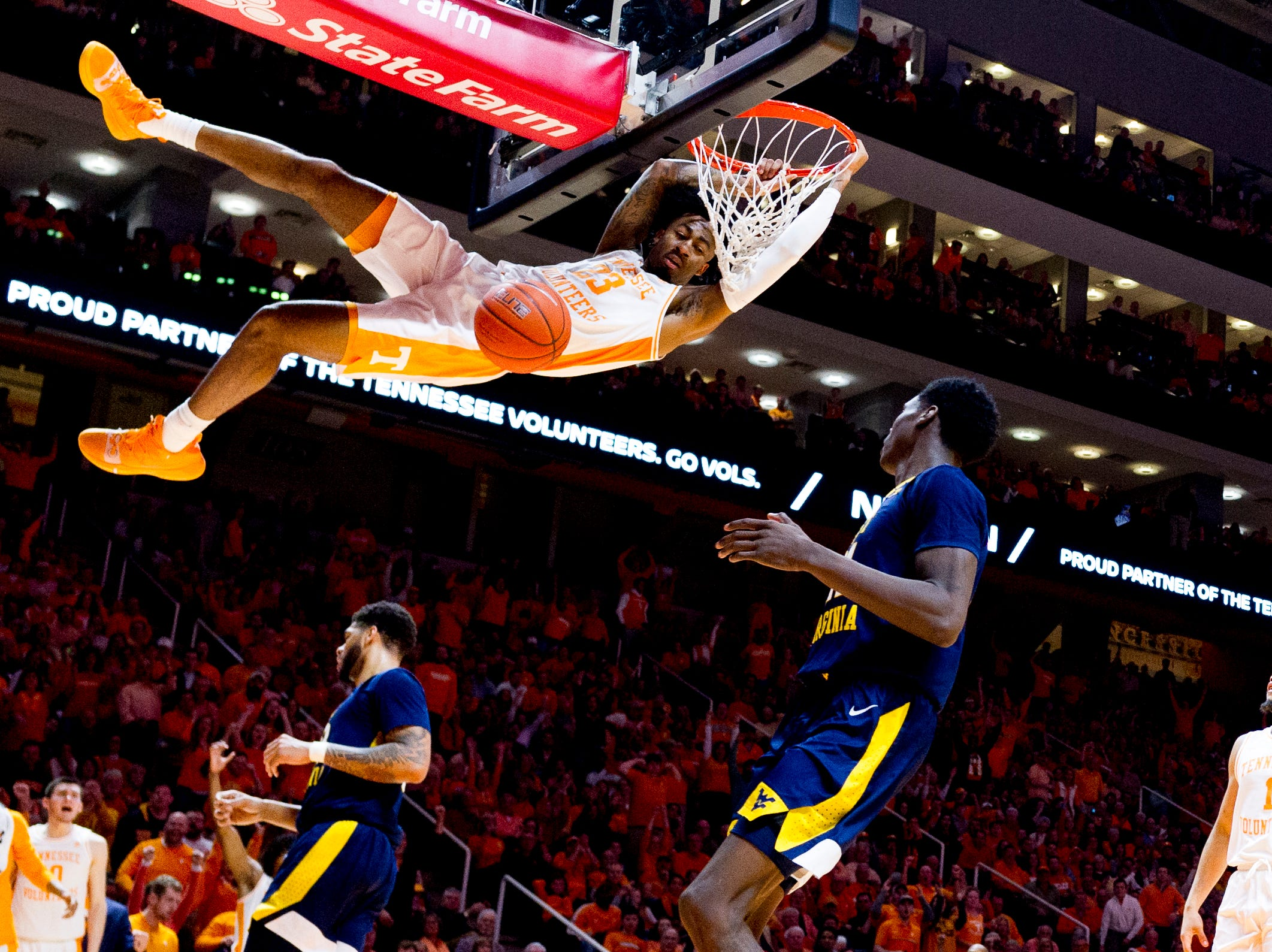 Tennessee guard Jordan Bowden (23) dunks during a SEC/Big 12 Challenge game between Tennessee and West Virginia at Thompson-Boling Arena in Knoxville, Tennessee on Saturday, January 26, 2019.