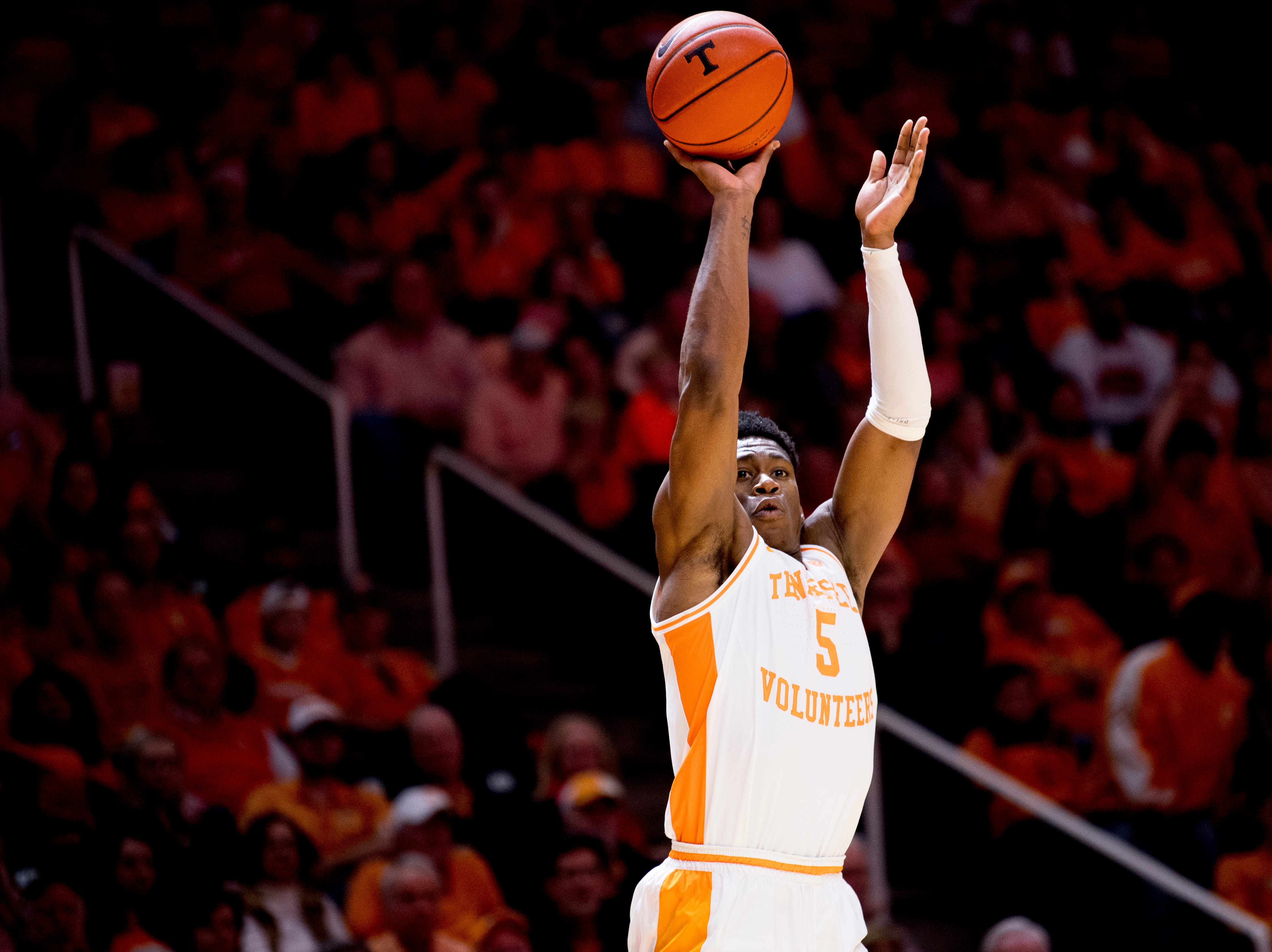 Tennessee guard Admiral Schofield (5) shoots for three points during a SEC/Big 12 Challenge game between Tennessee and West Virginia at Thompson-Boling Arena in Knoxville, Tennessee on Saturday, January 26, 2019.