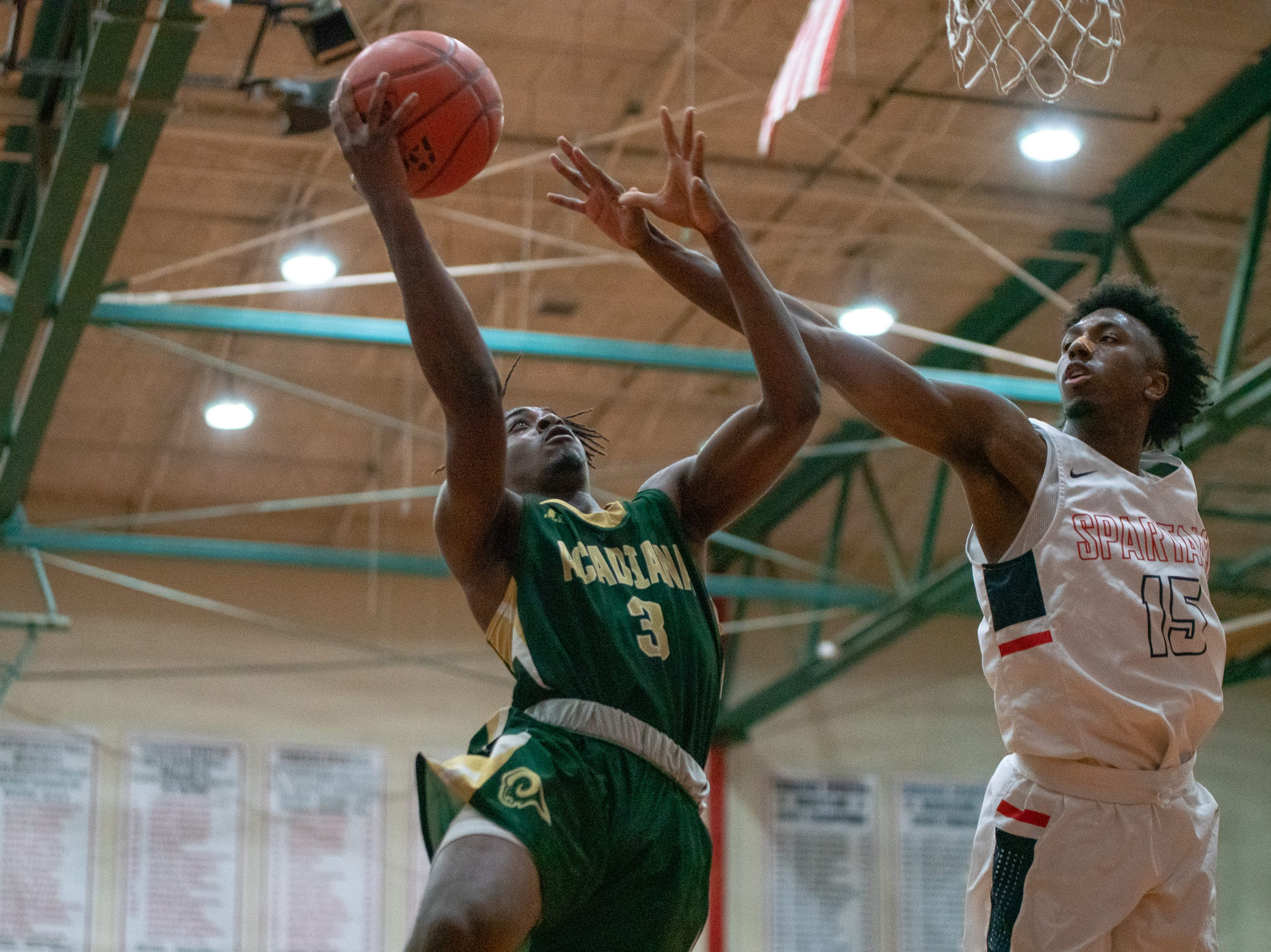 Acadiana High's Justin Dickerson (3) scores a layup during the play as the Comeaux High Spartans take on the Acadiana High Wreckin' Rams at Comeaux high school on Jan. 25, 2019.