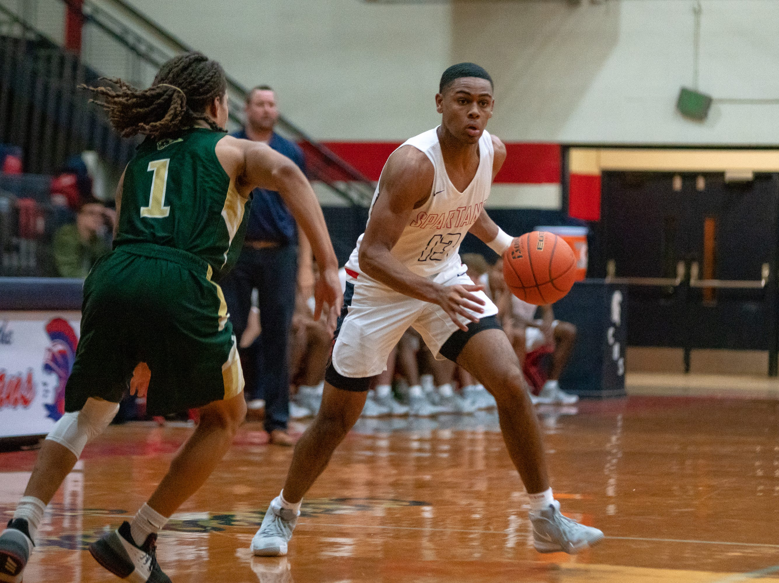 Comeaux's Tré Harris spots an open path to the goal as the Comeaux High Spartans take on the Acadiana High Wreckin' Rams at Comeaux High School on Jan. 25, 2019.