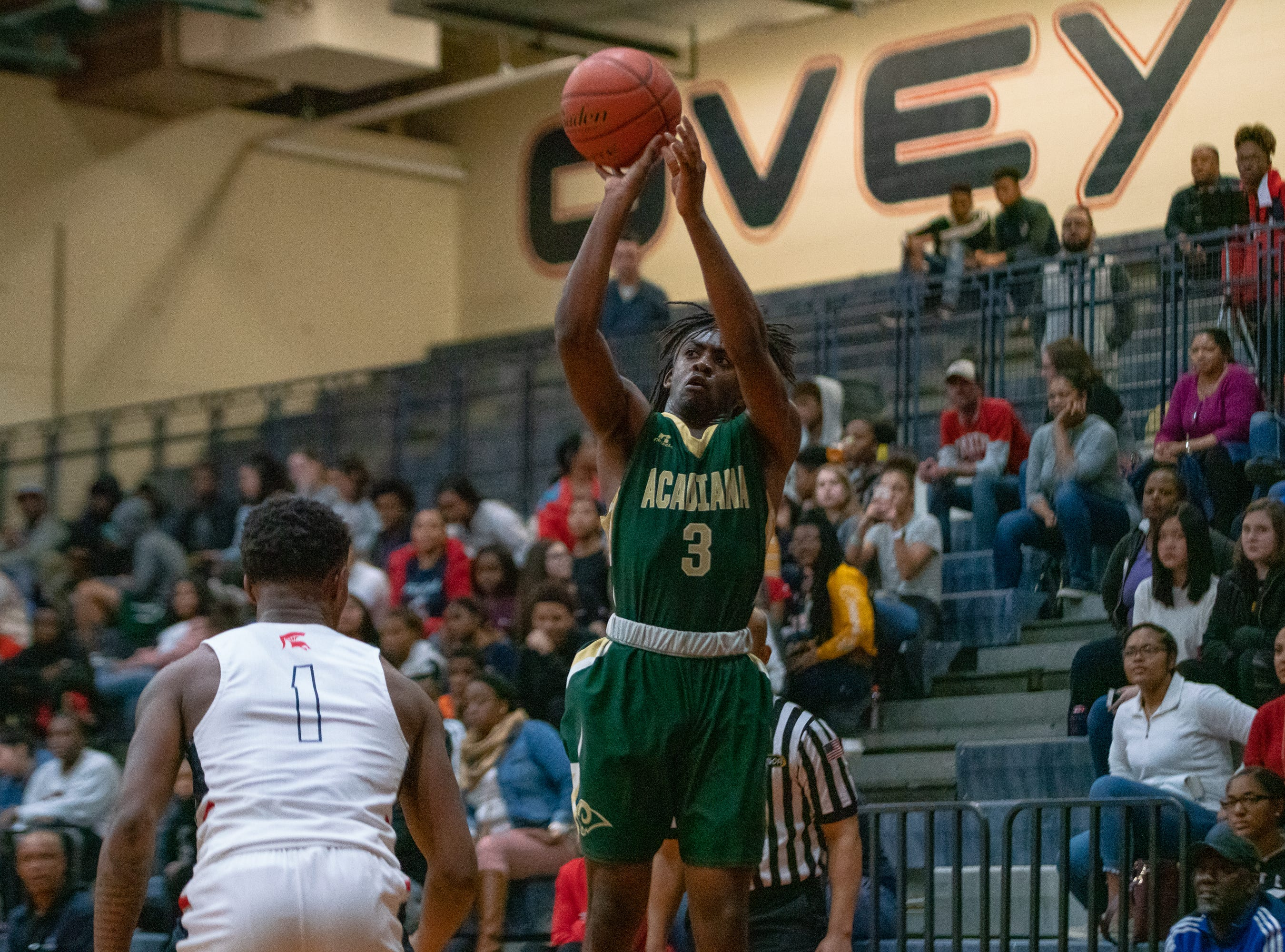 Acadiana High's Justin Dickerson (3) shoots a 3-pointer as the Comeaux High Spartans take on the Acadiana High Wreckin' Rams at Comeaux High School on Jan. 25, 2019.