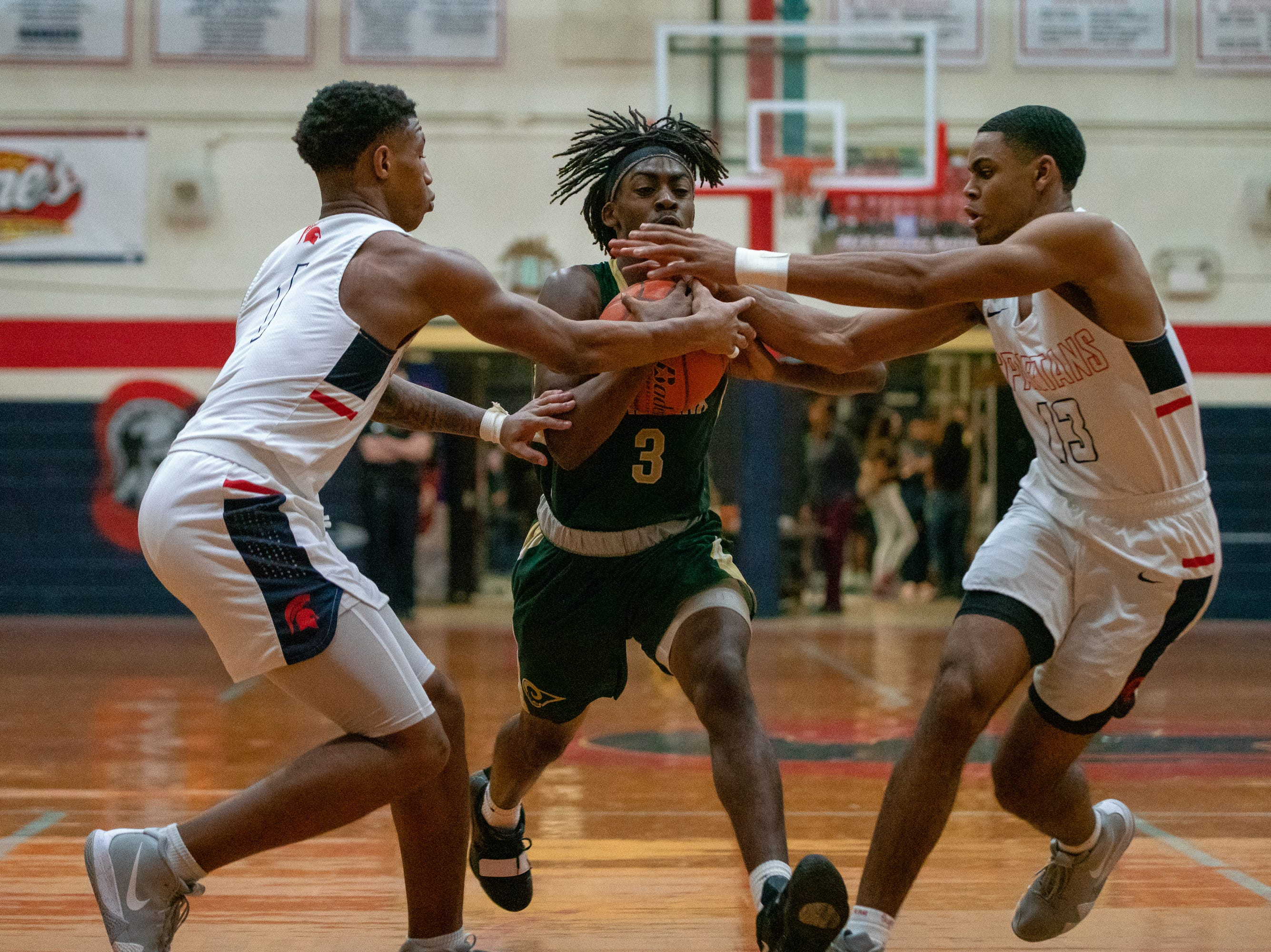 Acadiana High's Justin Dickerson (3) gets stopped by the defense while going to the goal as the Comeaux High Spartans take on the Acadiana High Wreckin' Rams at Comeaux high school on Jan. 25, 2019.