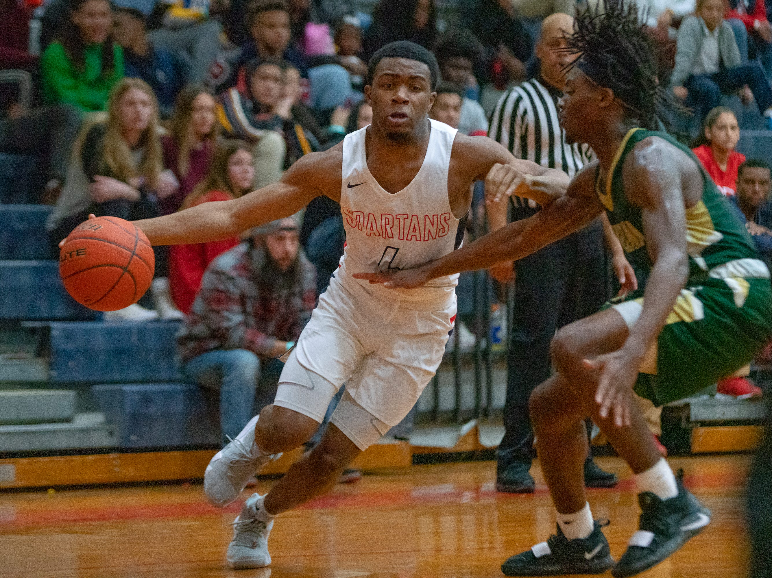 Comeaux High's Tyrone Young (4) drives the ball to the goal as the Comeaux High Spartans take on the Acadiana High Wreckin' Rams at Comeaux High School on Jan. 25, 2019.