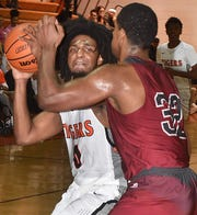 Opelousas High's Jayvon Fisher, shown here earlier this season against Dunham, led all scorers with 21 points in the Tigers' road upset of No. 2-ranked Breaux Bridge.