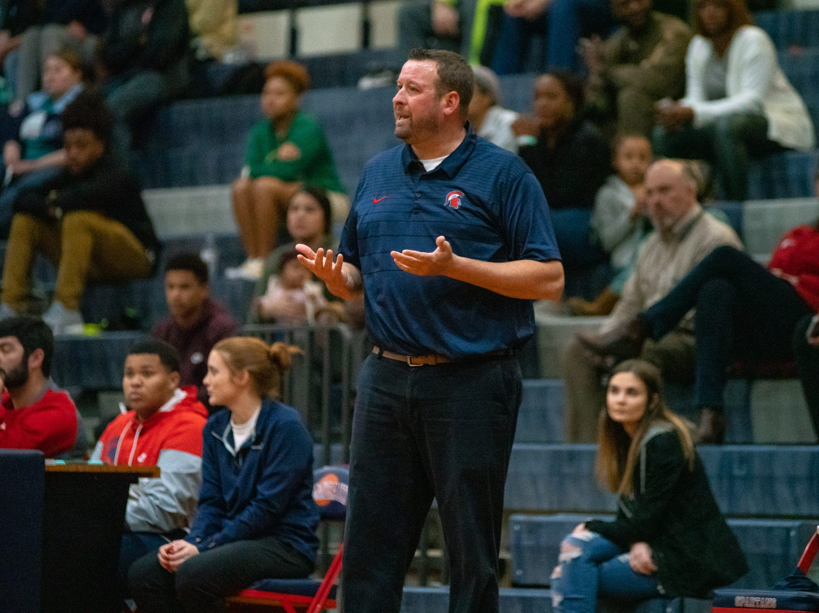 Comeaux High's head coach Jeremy Whittington questions a call from the officials as the Comeaux High Spartans take on the Acadiana High Wreckin' Rams at Comeaux high school on Jan. 25, 2019.