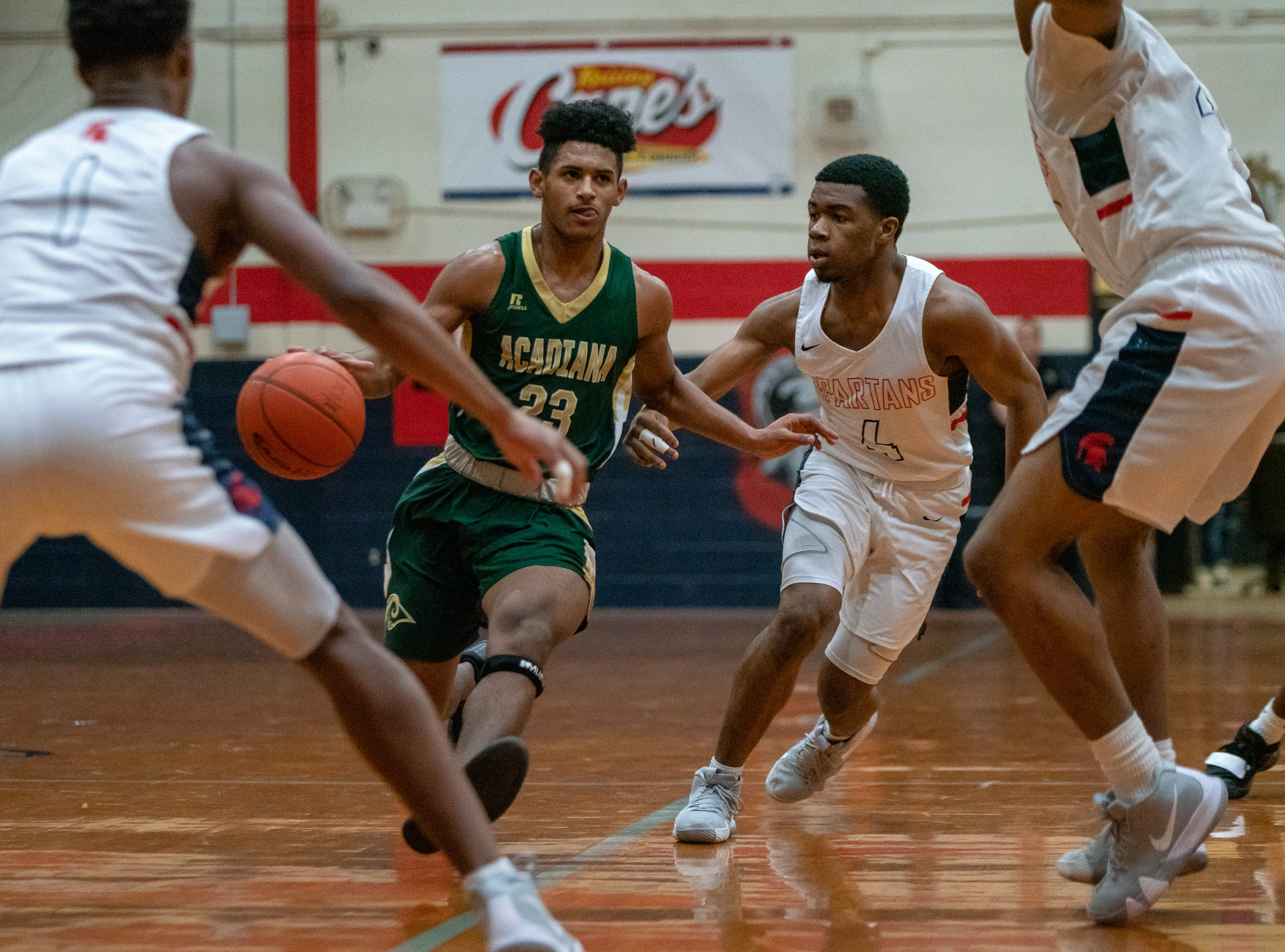 Acadiana High's Keontae Williams (23) moves the ball towards the basket as the Comeaux High Spartans take on the Acadiana High Wreckin' Rams at Comeaux high school on Jan. 25, 2019.