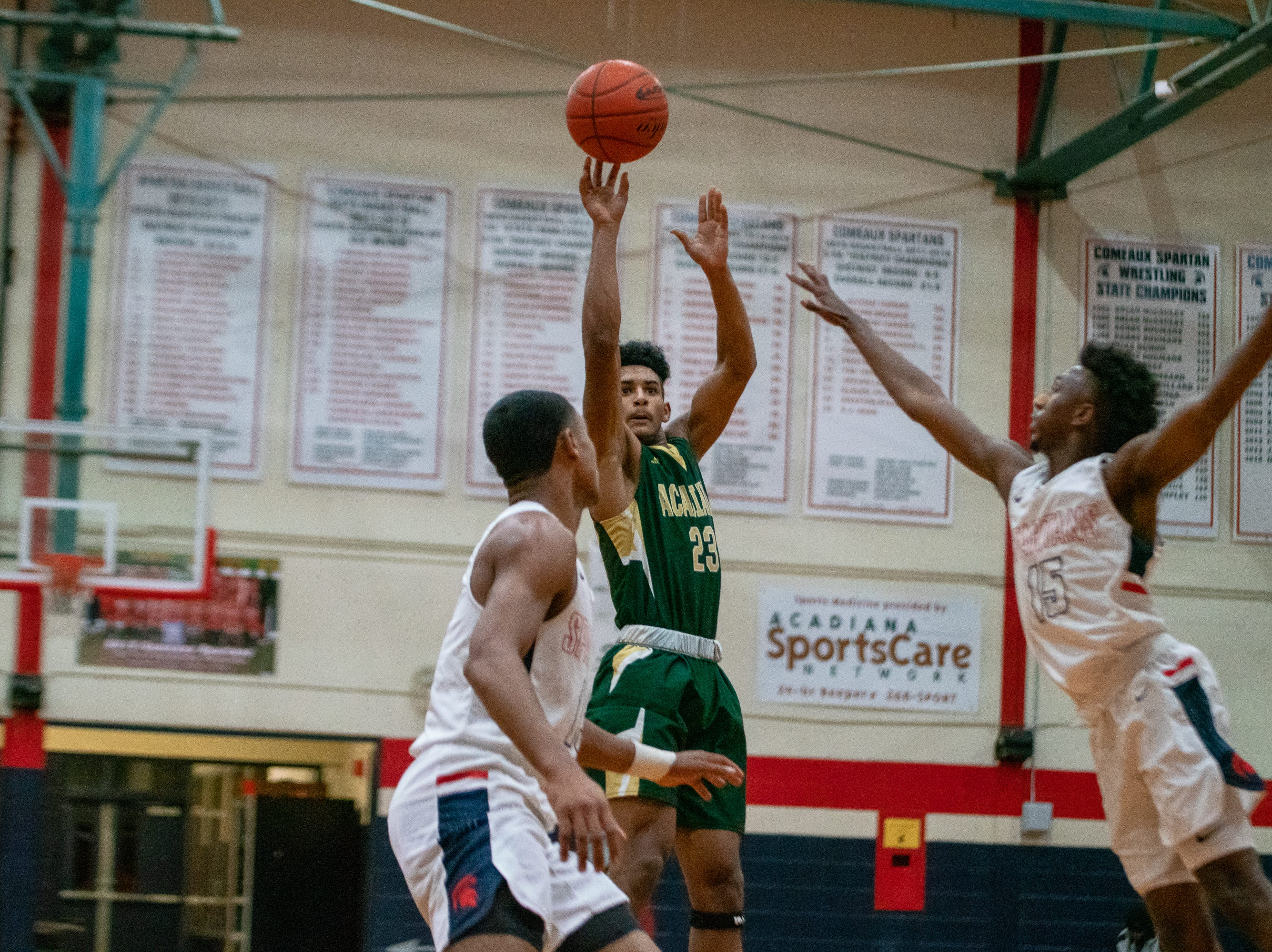 Acadiana High's Keontae Williams (23) shoots to score as the Comeaux High Spartans take on the Acadiana High Wreckin' Rams at Comeaux High School on Jan. 25, 2019.