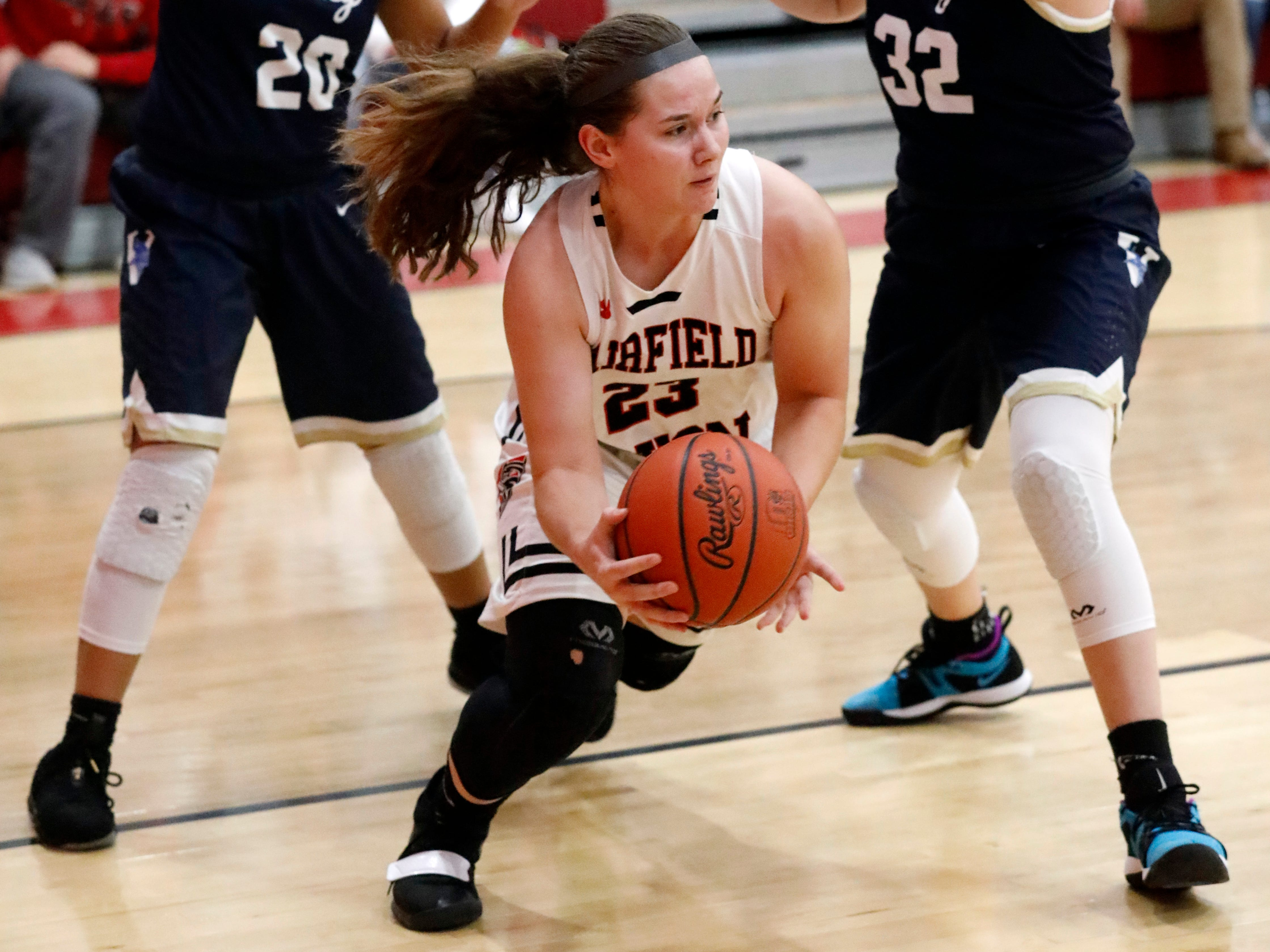 Fairfield Union's Marisa Malone drives through the alley Friday night, Jan. 25, 2019, against Teays Valley at Fairfield Union High School in Rushville. The Falcons lost the game 67-42.
