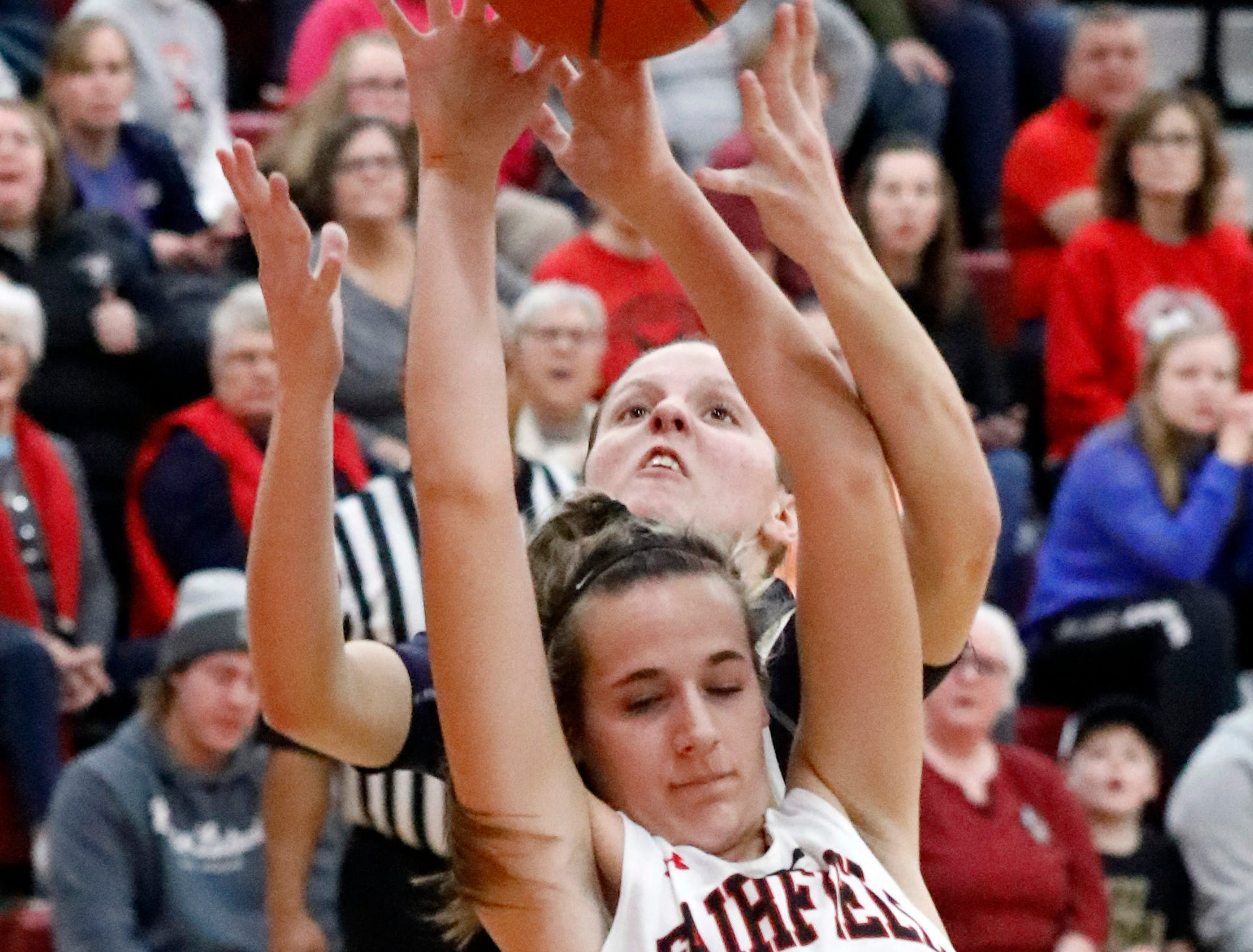 Fairfield Union's Hannah Rauch reaches back for a rebound as she and Teays Valley's Kierstyn Liming reaches for the ball Friday night, Jan. 25, 2019, at Fairfield Union High School in Rushville. The Falcons lost the game 67-42.