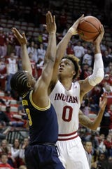 Indiana's Romeo Langford shoots over Michigan's Zavier Simpson during the second half of an NCAA college basketball game Friday, Jan. 25, 2019, Bloomington, Ind. Michigan won 69-46.