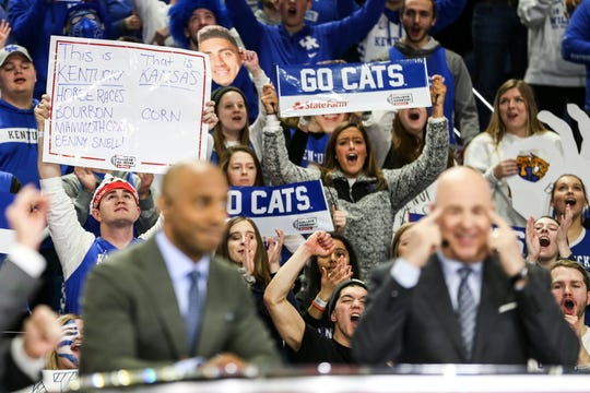 ESPN's Seth Greenberg points to his head as the UK fans roar behind him before the Kentucky-Kansas Saturday, January 26, 2019.