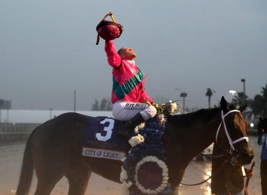Javier Castellano celebrates atop City of Light after winning the Pegasus World Cup Invitational Horse Race, Saturday, Jan. 26, 2019, at Gulfstream Park in Hallandale Beach, Fla.