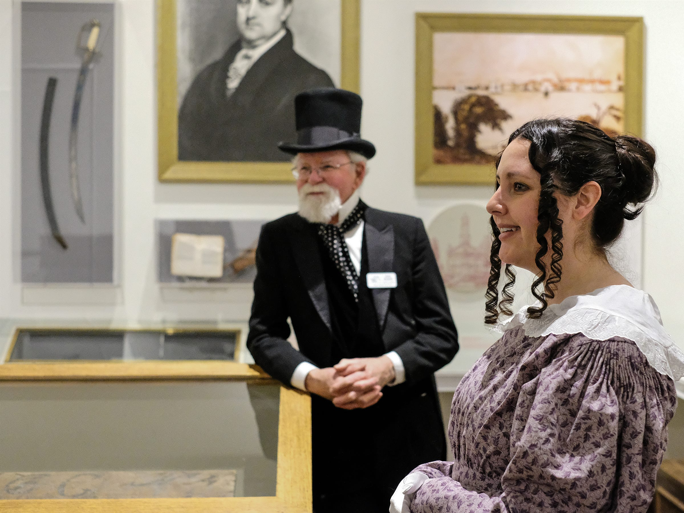 Docents, Christina Lee and Gary Koelsch talk to people about Michigan in the Statehood Room during the Welcome to Statehood Day 2019 event at the Michigan Library and Historical Center Saturday, Jan. 26, 2019. Michigan became a state on this day in 1837.