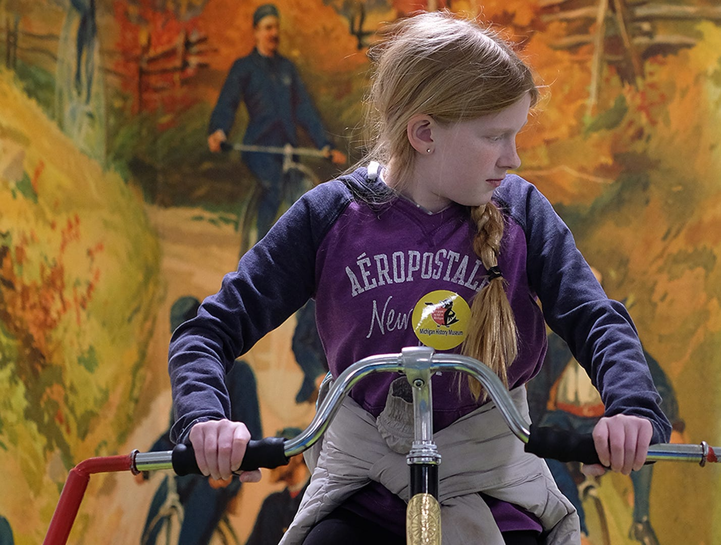 Ruby Francis, 11, from St. Joseph, rides the tall bike at the Welcome to Statehood Day 2019 event at the Michigan Library and Historical Center Saturday, Jan. 26, 2019. Michigan became a state on this day in 1837.
