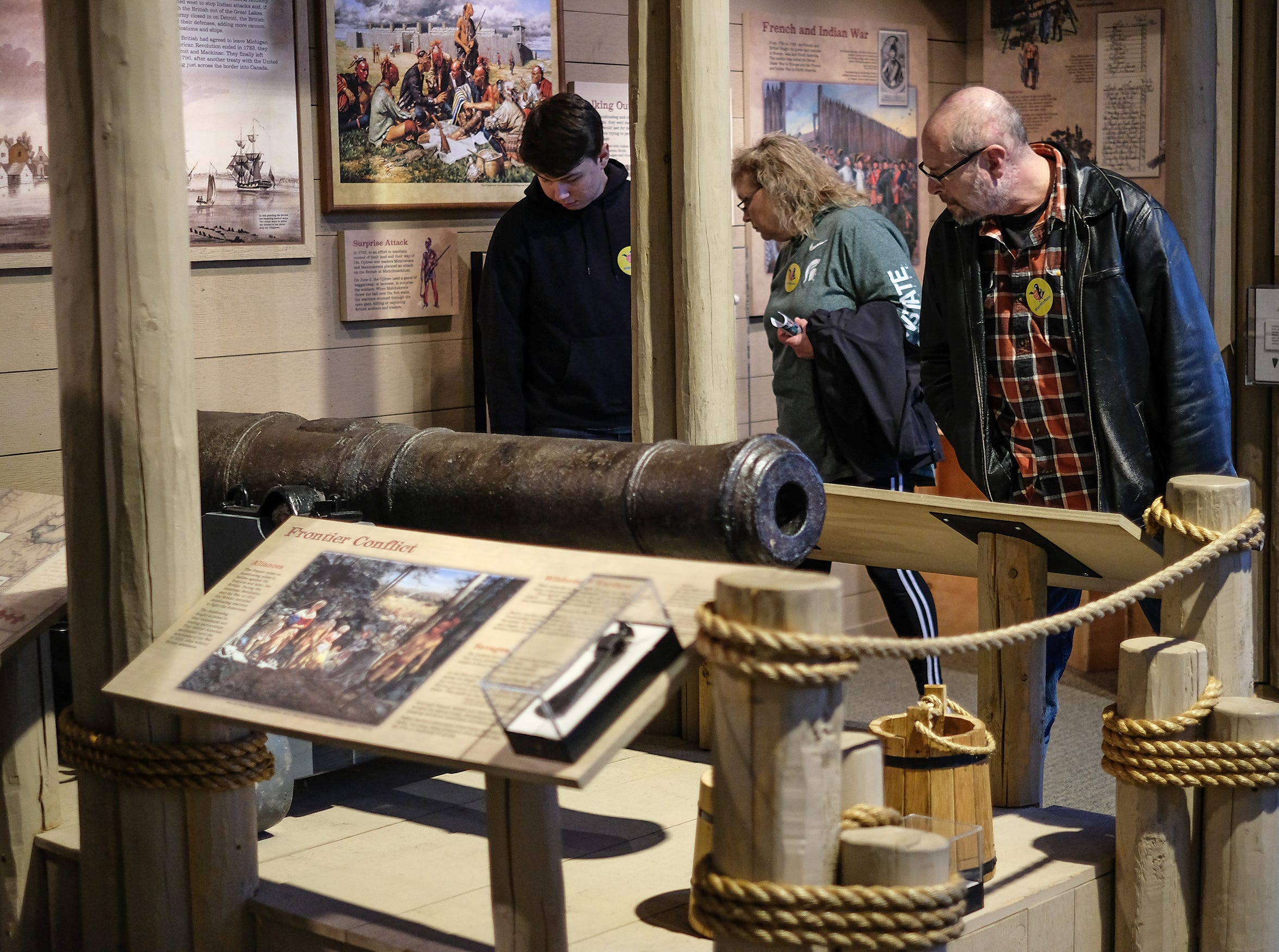 People check out the restored cannon that was pulled out of the Detroit River at the Welcome to Statehood Day 2019 event at the Michigan Library and Historical Center Saturday, Jan. 26, 2019. Michigan became a state on this day in 1837.