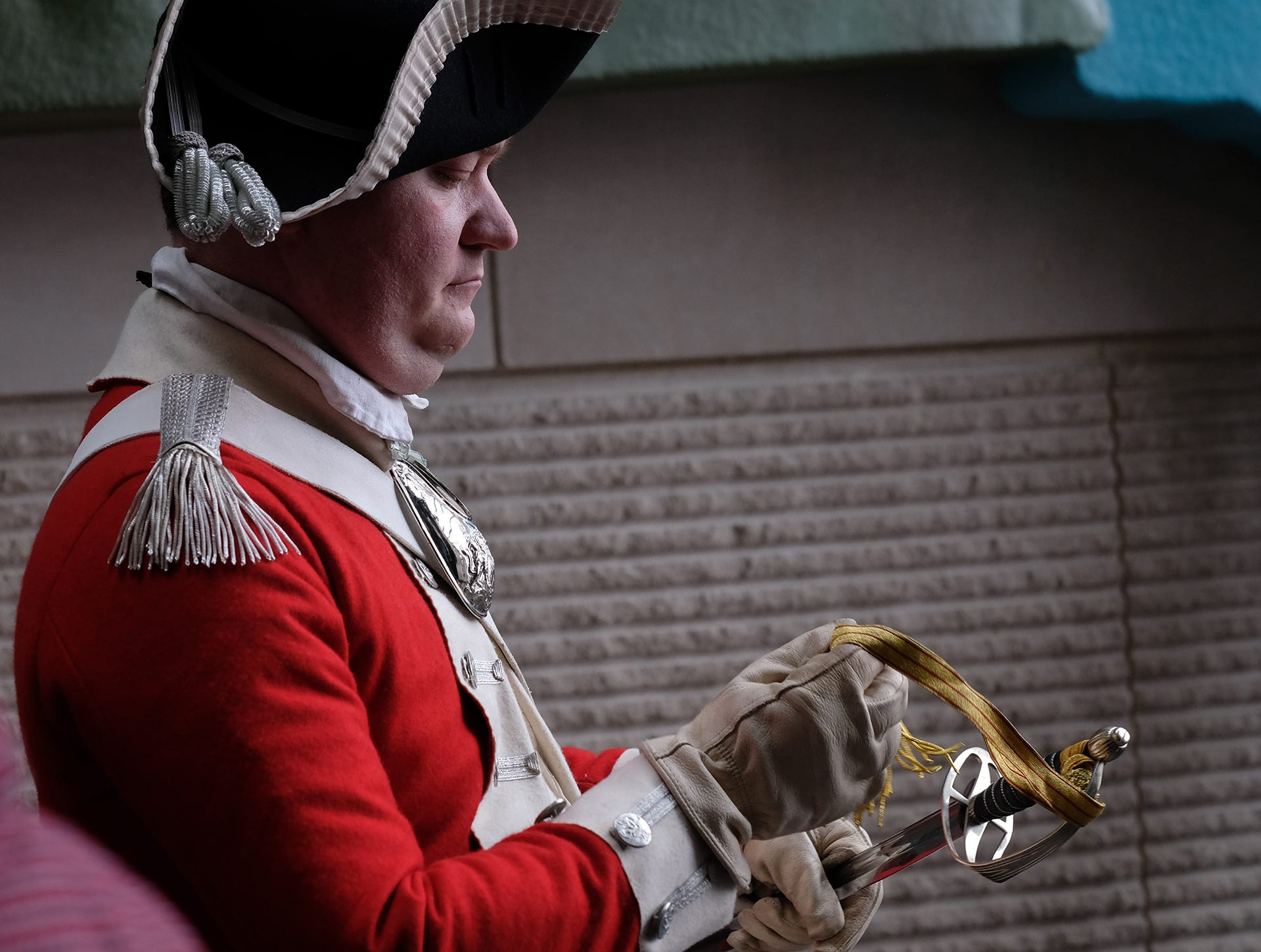 A docent portrays a British redcoat and explains the parts of his sword at the Welcome to Statehood Day 2019 event at the Michigan Library and Historical Center Saturday, Jan. 26, 2019. Michigan became a state on this day in 1837.