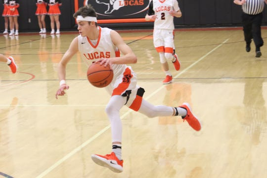 Lucas' Riley Gossom drives to the basket during the Cubs' win over Crestline earlier in the season.
