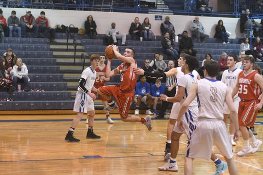 Loudonville's Jacob Gessner drives to the hoop in Friday night's game at St. Peter's.