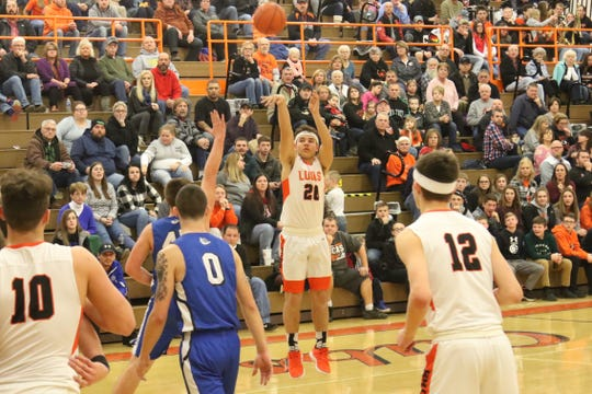 Lucas' Jeb Grover elevates for a 3-pointer in the Cubs' win over Crestline earlier in the season.