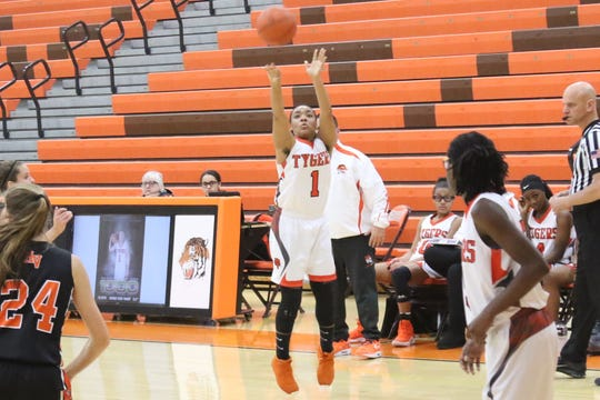 Mansfield Senior's Talayzha Catchings drills a 3-pointer in the Lady Tygers' win over Mount Vernon on Saturday. Catchings joined the elite 1,000-career point club in the victory.