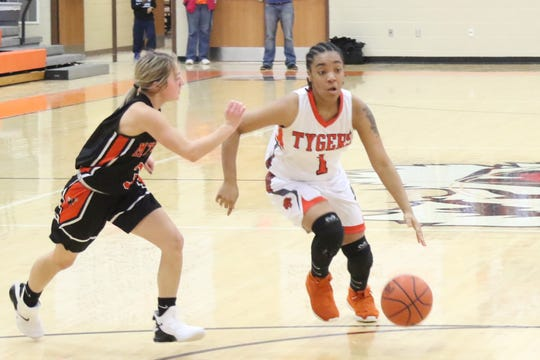 Mansfield Senior's Talayzha Catchings drives to the basket for her 1,000th-career point in the Lady Tygers' victory over Mount Vernon on Saturday.
