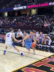 Ridgdale Clayton Lust looks to drive the baseline in Quicken Loan Arena last winter in Cleveland before a Cavaliers game. Licking Valley won the game 47-41.