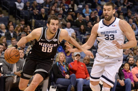 Sacramento Kings forward Nemanja Bjelica (88) drives next to Memphis Grizzlies center Marc Gasol (33) during the first half of an NBA basketball game Friday, Jan. 25, 2019, in Memphis, Tenn. (AP Photo/Brandon Dill)